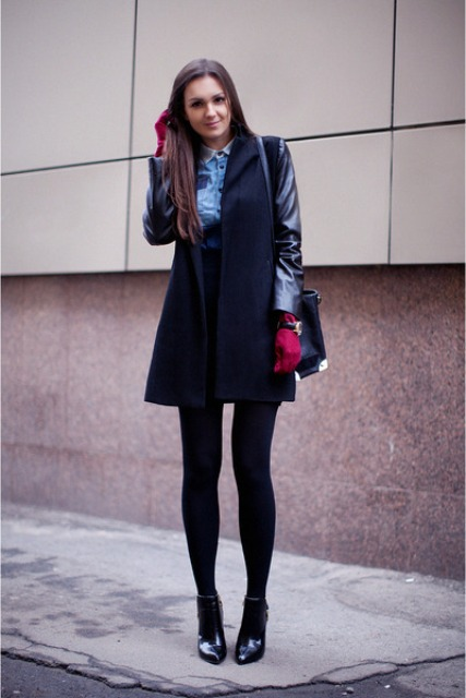 With denim shirt, mini skirt, black tights and ankle boots
