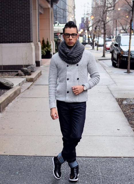 Men outfit with a scarf, double-breasted cardigan, cuffed jeans and boots