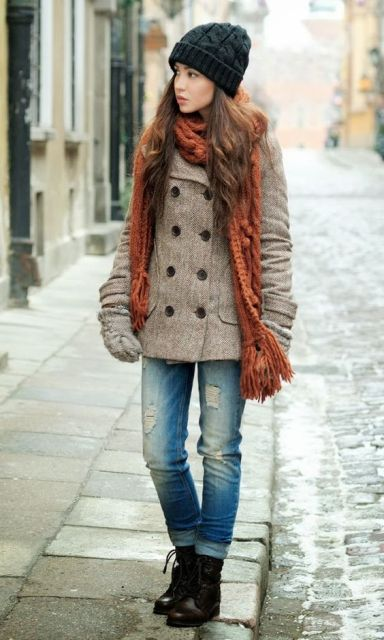 With double-breasted coat, cuffed jeans, mid calf boots and beanie
