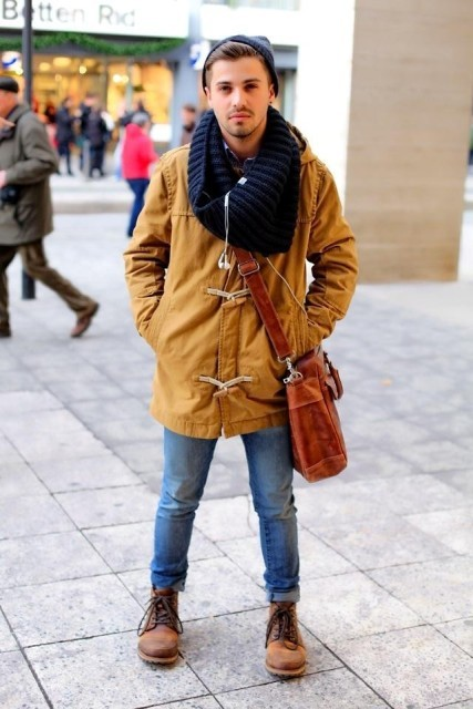 With duffle coat, cuffed jeans, brown boots, beanie and crossbody bag