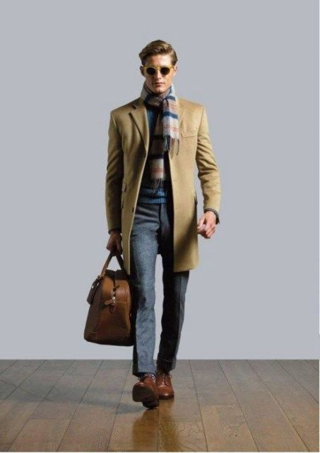 With elegant coat, tweed trousers, leather brown boots and big bag