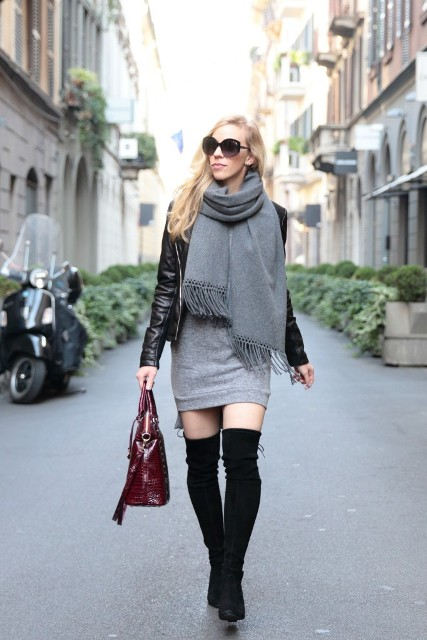 With gray dress, over the knee black boots, leather jacket and marsala bag