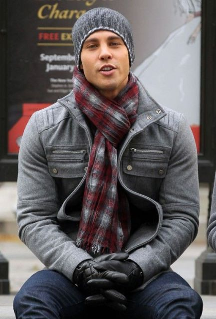 With gray jacket, beanie and jeans