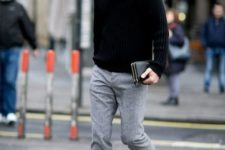 With gray pants, sneakers and felt hat