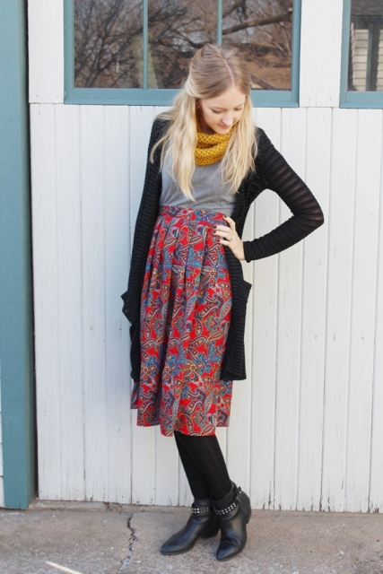 With gray shirt, midi skirt, long cardigan and ankle boots