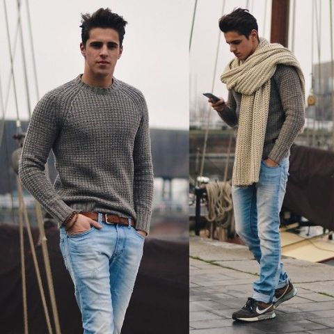 With gray sweater, jeans and sneakers