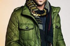 With green puffer jacket and denim shirt