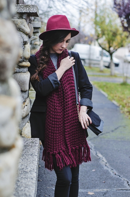 With hat, black jacket and sweater