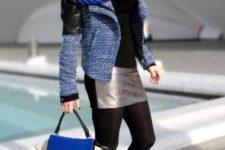 With jacket, metallic skirt, black shirt and color block bag