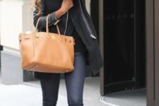 With jeans and big brown leather bag