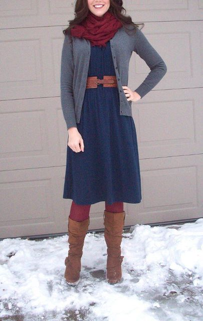 With knee-length blue dress, belt, gray cardigan and high boots