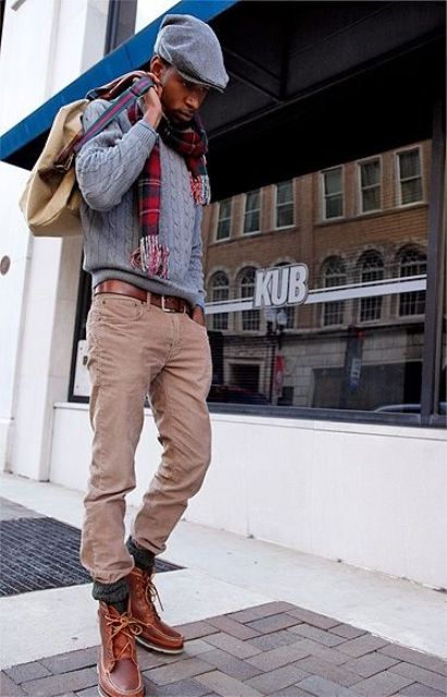 With knitted sweater, suede pants, belt, mid calf boots and cap