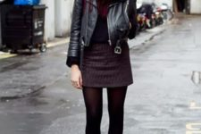 With leather jacket, shirt, mini skirt, black tights and ankle boots