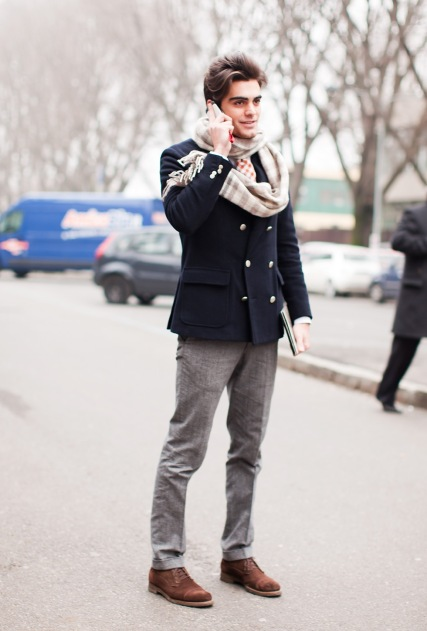 With light gray trousers, navy blue double breasted jacket and suede boots