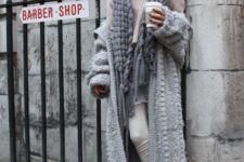 With light pink sweater, white pants and knitted long cardigan
