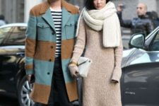 With long sweater and clutch