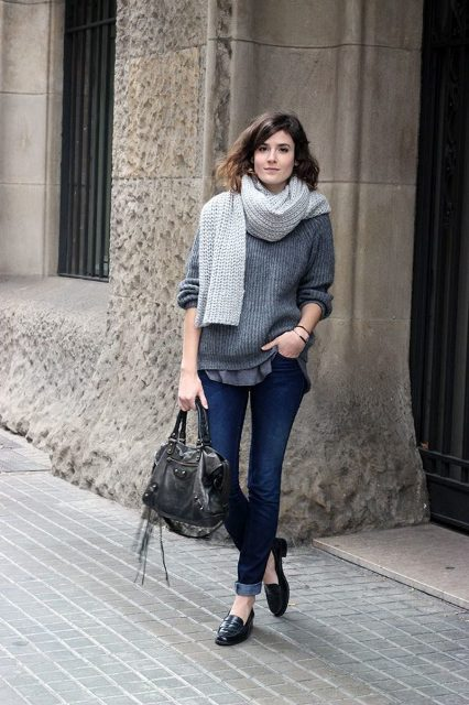 With loose sweater, cuffed jeans, shoes and simple bag