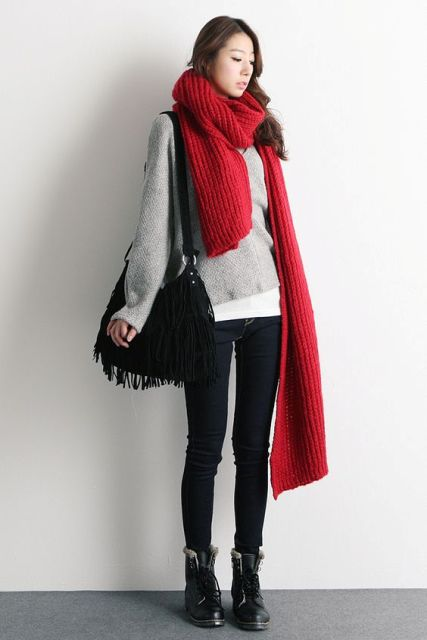 With loose sweatshirt, skinnies, boots and fringe bag