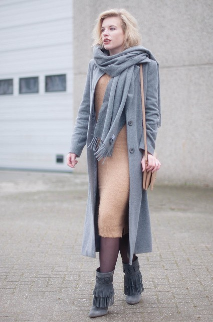 With midi dress, gray coat and fringe boots