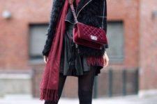 With mini skirt, jacket and marsala bag