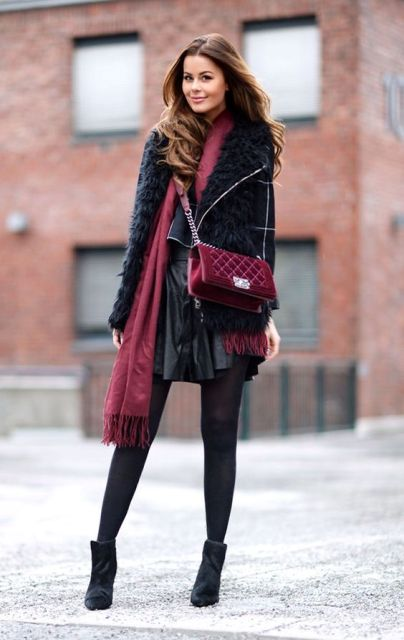 With mini skirt, jacket and marsala bag