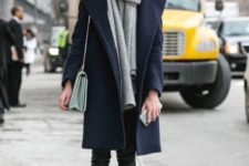 With navy blue coat, high boots and pants