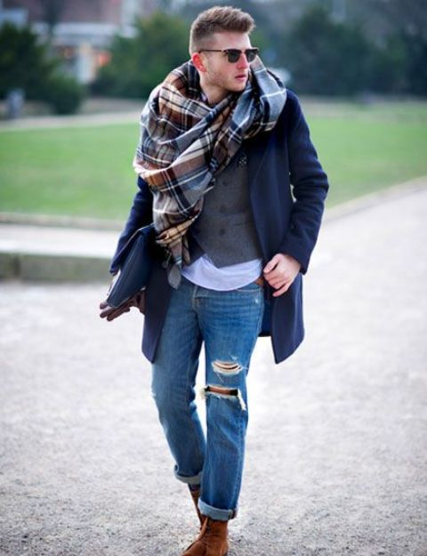 With navy blue coat, vest, jeans and suede boots