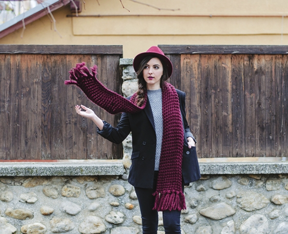 With navy blue jacket, skinnies and marsala hat
