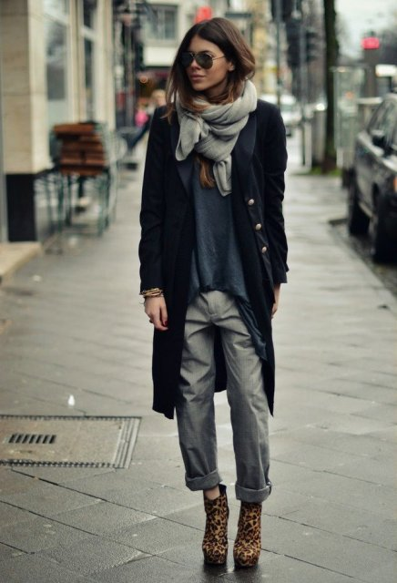 With oversized shirt, cuffed gray trousers, leopard ankle boots and knee-length coat