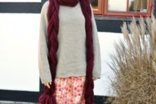 With oversized sweater, printed skirt and black tights