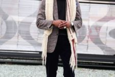 With printed jacket, hat, black trousers and boots