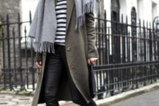With printed shirt, leather pants, sneakers and olive green coat