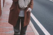 With printed trousers, brown ankle boots and brown coat