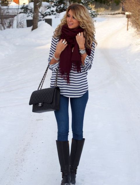 With skinnies, striped shirt, high boots and chain strap bag