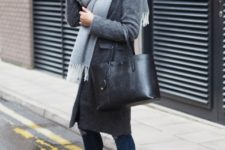 With skinny jeans, straight coat, black tote and ankle boots