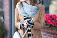 With striped shirt, camel coat and crossbody bag