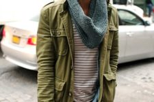 With striped shirt, green army jacket and jeans