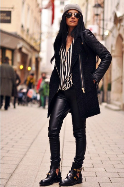 With striped shirt, leather pants and flat ankle boots