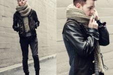 With striped shirt, leather sleeve jacket, dark color jeans and mid calf boots