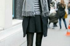 With striped shirt, mini skirt, black tights, ankle boots and coat
