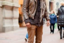With sweater, leather jacket, brown pants and white boots