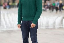 With turtleneck, cuffed jeans and brown shoes