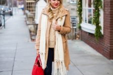 With turtleneck sweater, leggings, boots and red bag