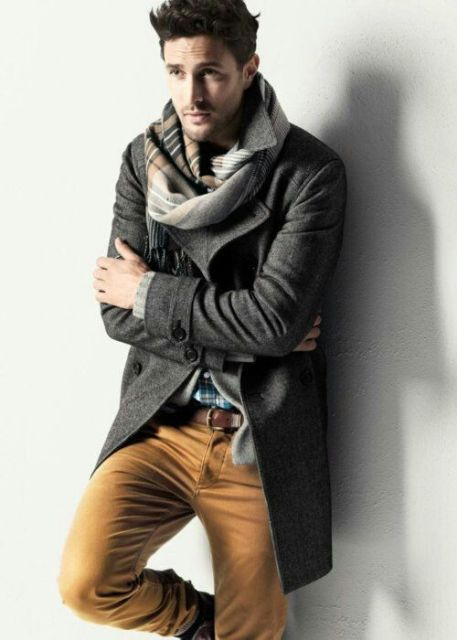 With tweed coat and light brown pants