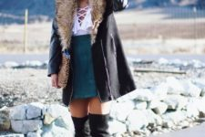 With white blouse, suede skirt, black hat and over the knee boots