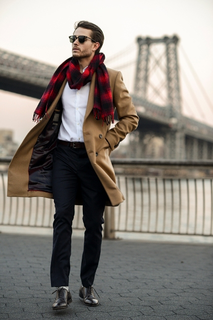 With white button down shirt, camel coat and black trousers