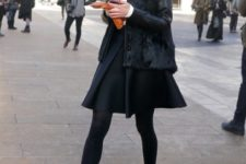 With white shirt, black skirt, black tights and ankle boots