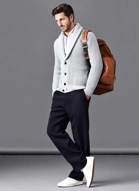With white shirt, navy blue pants, white sneakers and leather backpack