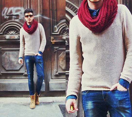 With white sweater, jeans and brown mid calf boots