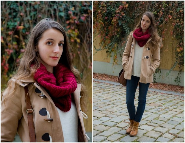 With white sweater, jeans, brown boots and duffle coat